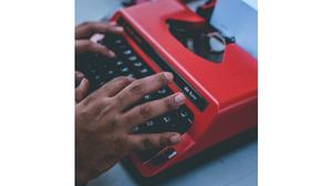 hands at typewriter