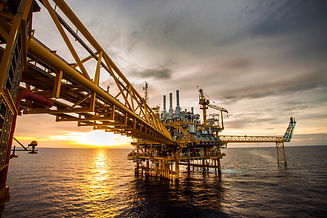 Offshore oil and rig platform in sunset