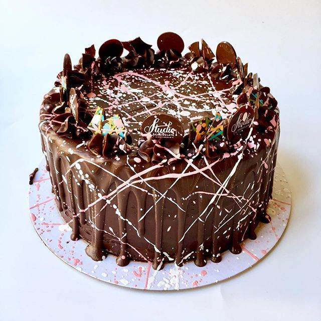 Chocolate cake with ganache and paint splatters