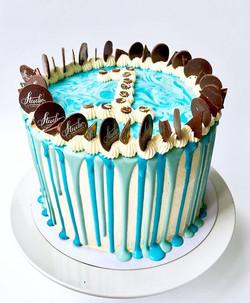 Brightly coloured cake drip