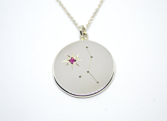 Cancer constellation pendant set with a ruby birthstone