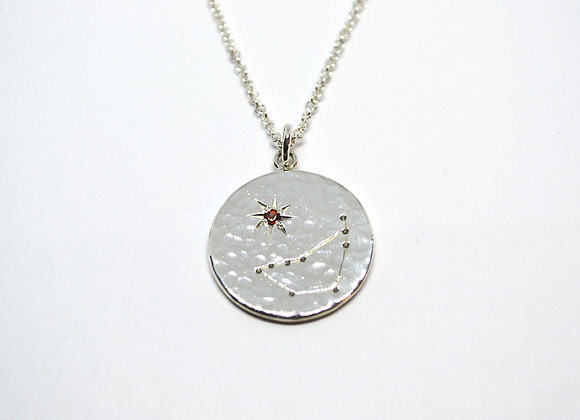 Capricorn constellation pendant with garnet birthstone