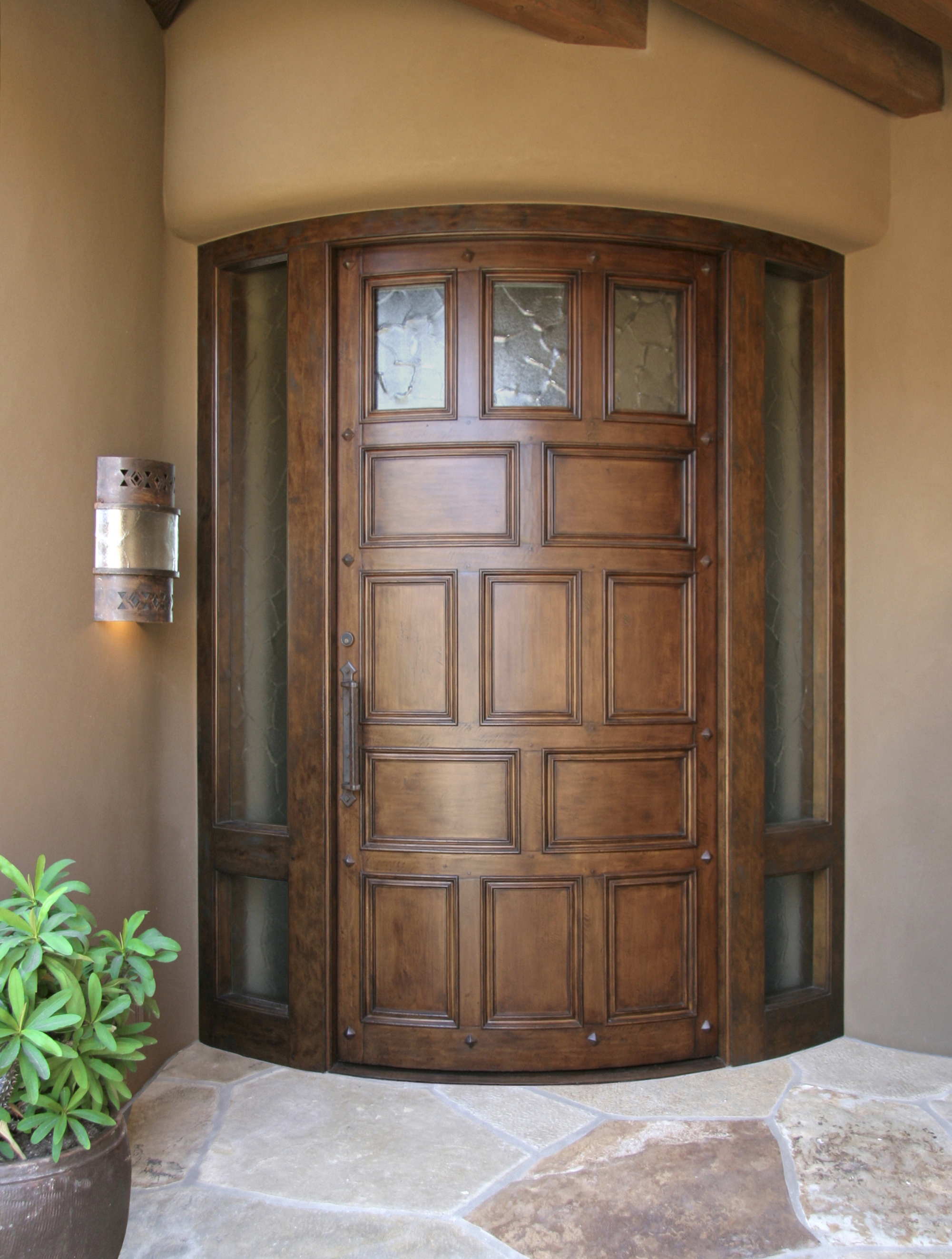 Antiqued Curved Entry Door