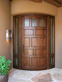 Antiqued Curved Entry Door