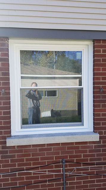 A double hung window with capping