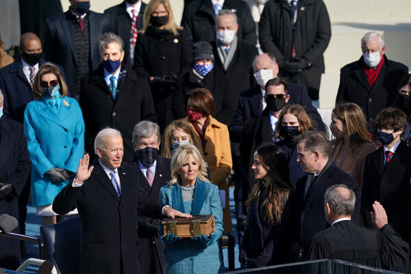 Biden's first day: 'Cascading crises of our era'