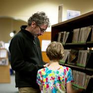 Man and child at bookshelf