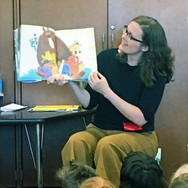Librarian reading to group of children