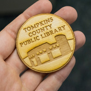 Hand holding button with TCPL logo