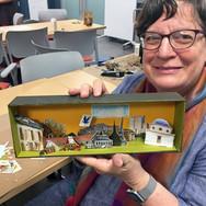 Woman holding handmade diorama