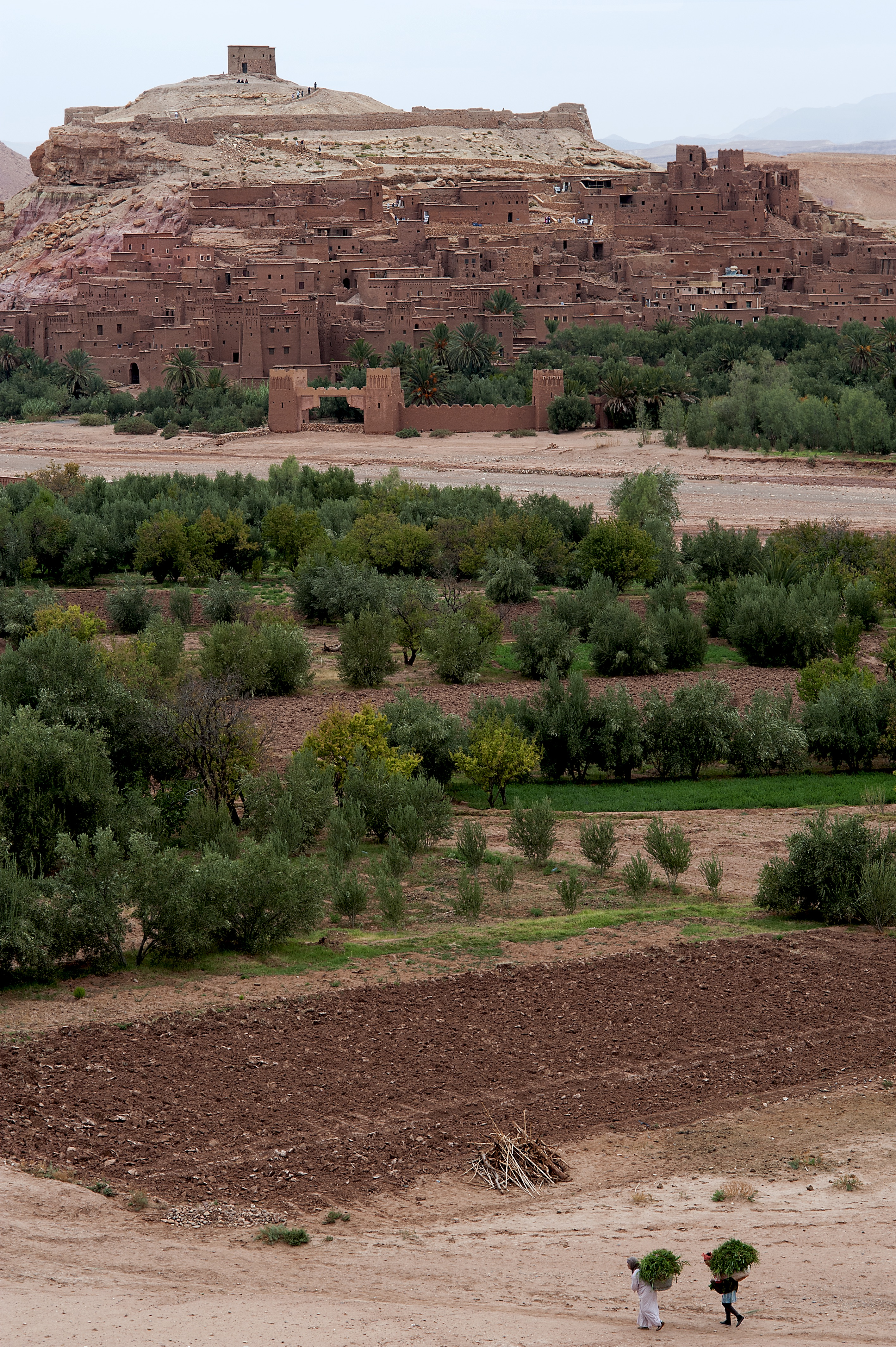 Ait Benhaddou and farmers carrying hay bales
