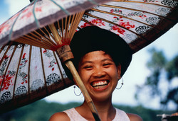 Smiling Yi Woman with Umbrella