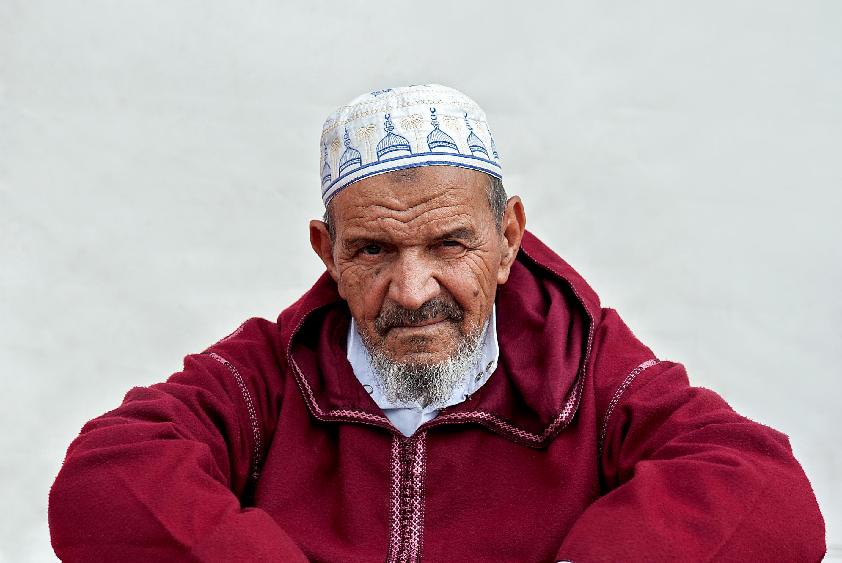 Muslim man, red & white portrait
