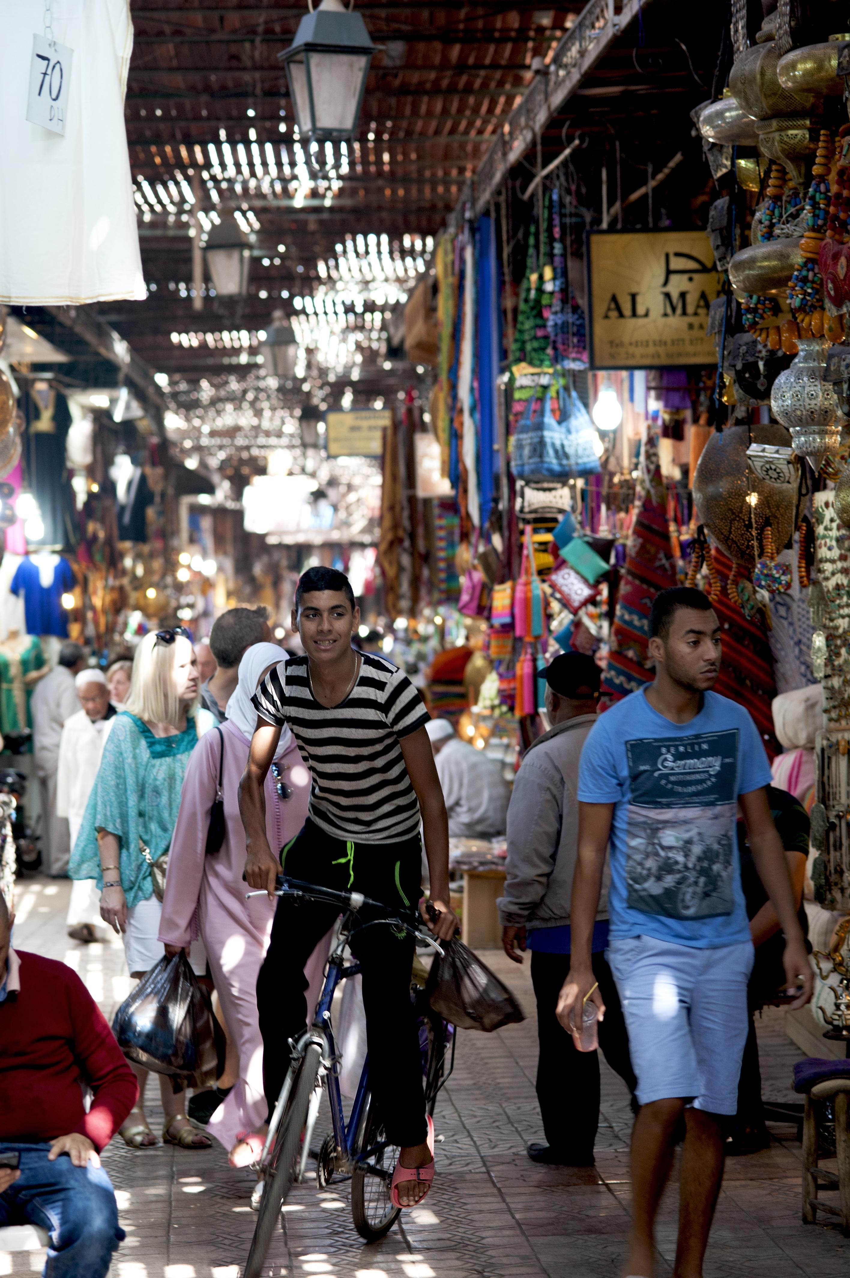 Cyclist in Medina souk, Marrakesh