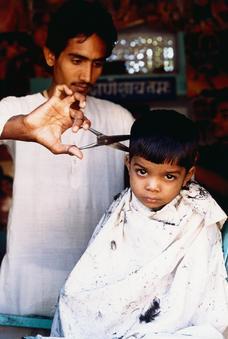 Boy's haircut, Rajasthan