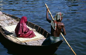Boatman ferries a Muslim woman