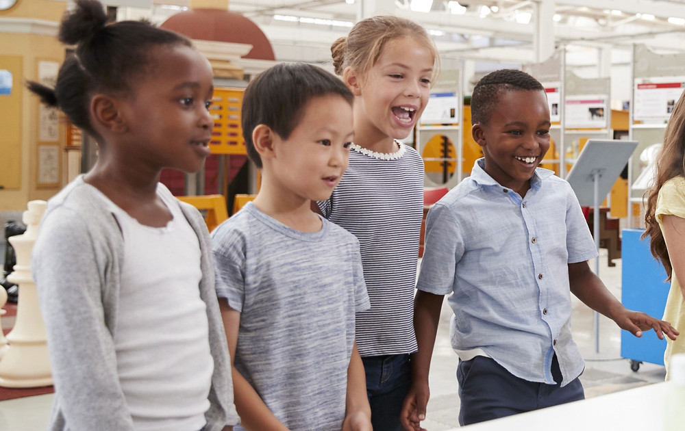 Kids of all races in a lab