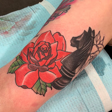 Bold and bright traditional tattoo with a knight chess piece. Creation by Jay Jones