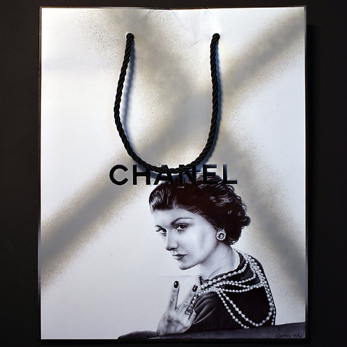 Ballpoint pen on Chanel bag of Coco Chanel giving the bird by James Mylne. Sold at the Affordable Art Fair Battersea