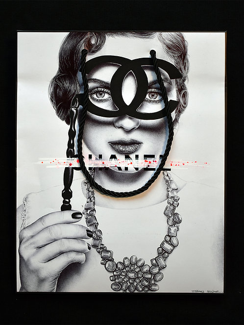 Ballpoint pen on Chanel bag of Coco Chanel holding some glasses. The glasses form the CC Chanel logo by James Mylne. AAF