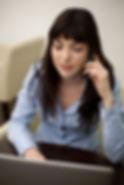 電話での女