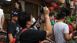 A participant taking photos during a Born in Film Photowalk event