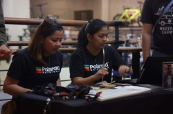 Polaroid personnel prepares for the Born in Film and Polaroid's film photography workshop