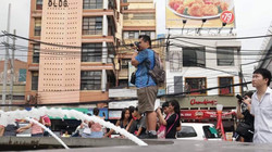 Photographers taking pictures in Binondo during a Born in Film Photowalk event