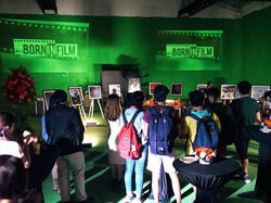 Guests look on as Born in Film's first exhibit begins