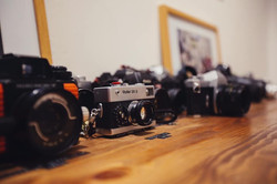 A collection of cameras at StratoBOX Studios Gallery