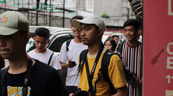 Participants walking during a Born in Film Photowalk event