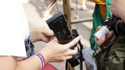 A participant reloading a film camera