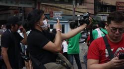 A participants taking a photo at a a Born in Film Photowalk event