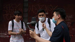 Participants being interviewed by Franz Lopez during a Born in Film Photowalk event