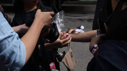 A participant wraps wrist with an event Tyvek