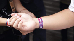 A participant being wrapped with a wrist band for the the event