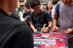 Participants signing the Gathering II poster