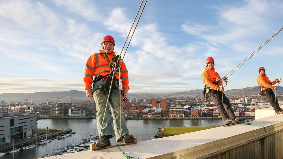 Vertical World UK team abseiling from ARC appartments in Belfast.