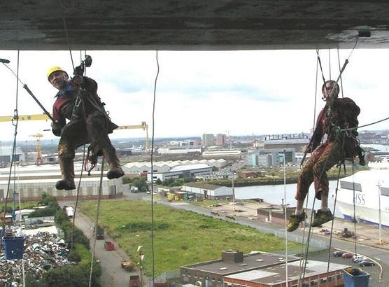 Vertical World UK team painting Hendersons Cranes in Belfast.
