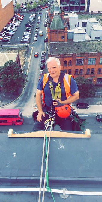 Vertical World UK Chief Problem Solver John Kelly abseiling from office block in Belfast.