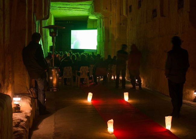Screening the movie ''The cave connection'' in a cave for the Dutch Mountain Film Festival