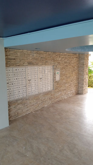 Mail room wall finished with stacked stone