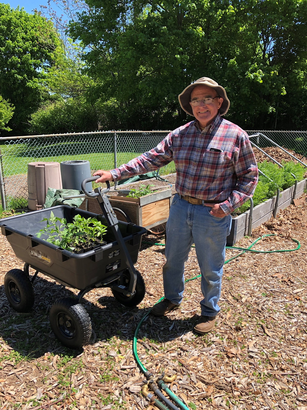 Gene Renz, Head Gardener of the Pawcatuck Neighborhood Center (PNC), graciously accepting the new garden cart and seedlings given by ECCGA! The PNC grows hundreds of pounds of fresh produce yearly that is available free of charge at PNC's food bank.
