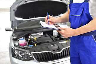 Vehicle-maintenance-staff-do-car-maintenance-records-Stock-Photo.jpg