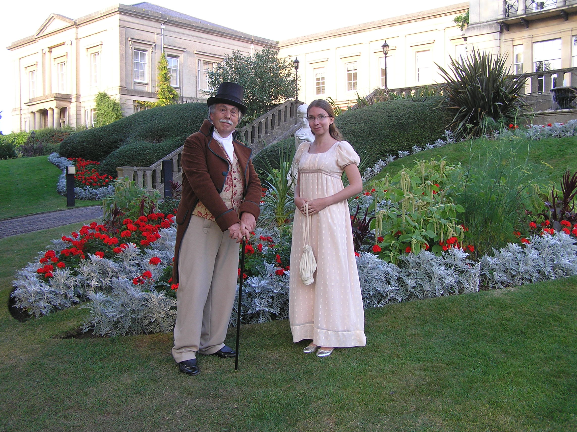 Regency couple in front of mansion.jpg