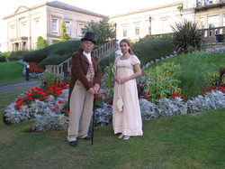 Regency couple in front of mansion.jpg
