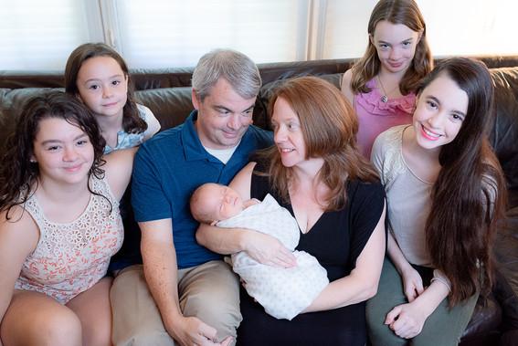 Mom, dad, newborn boy and four sisters