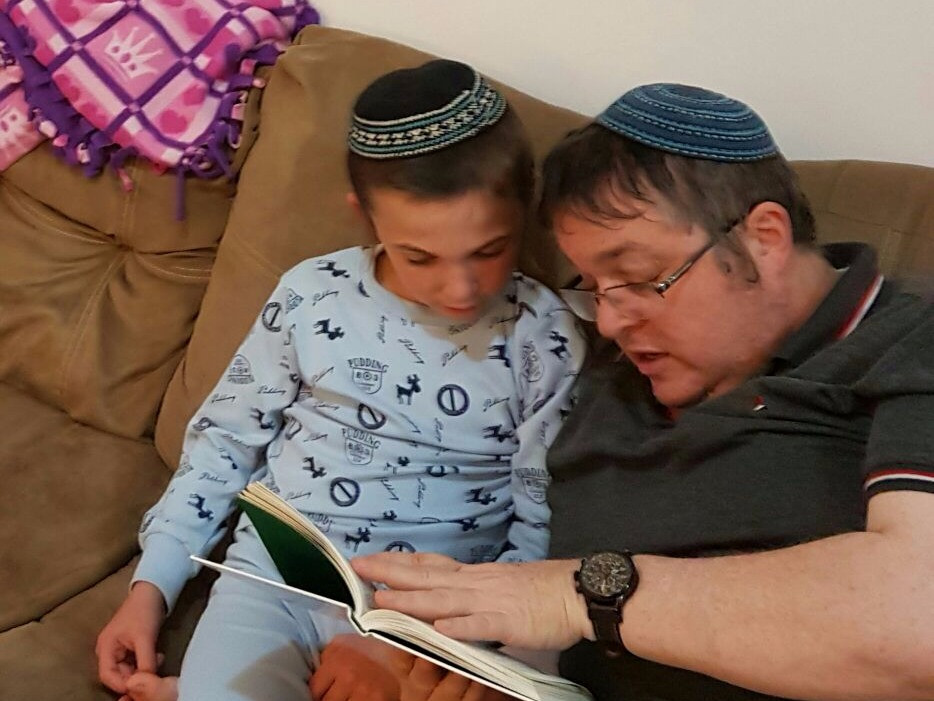 Father and son read together for the Readathon