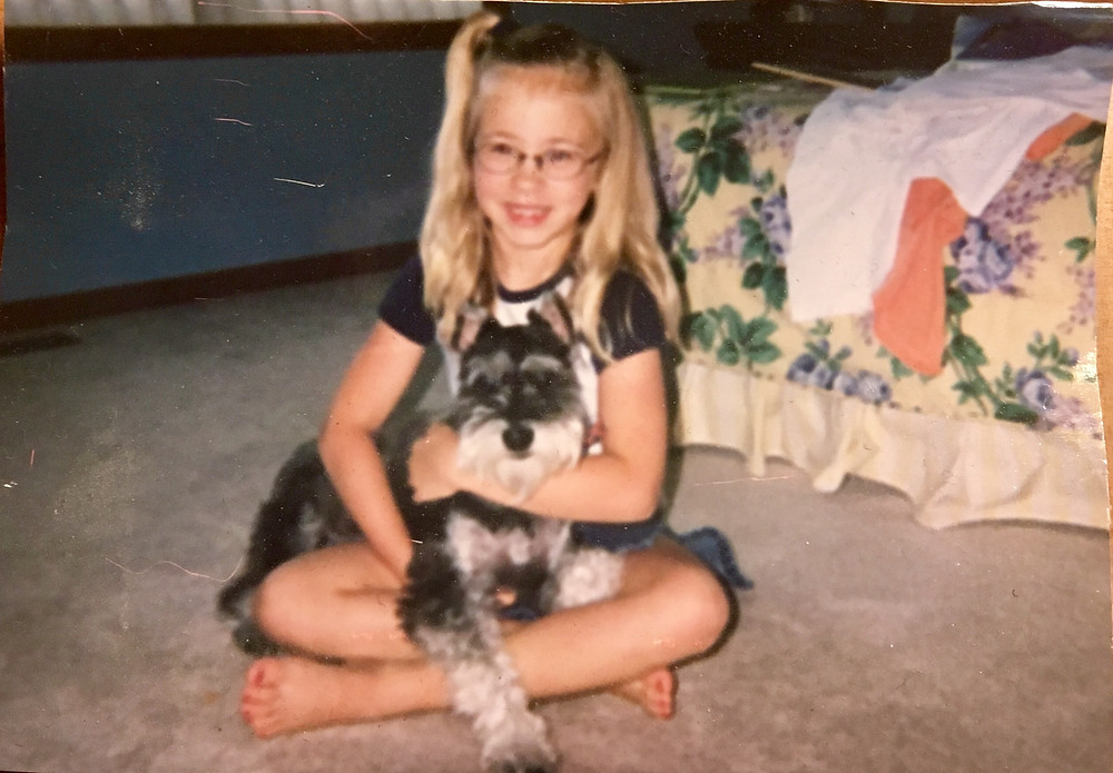 A young girl and her dog.