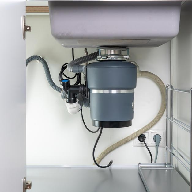 Garbage Disposal under the modern sink,